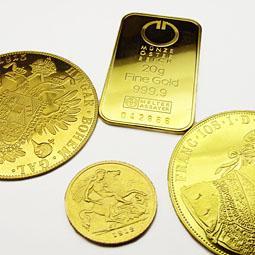 Złote sztabki i złote monety